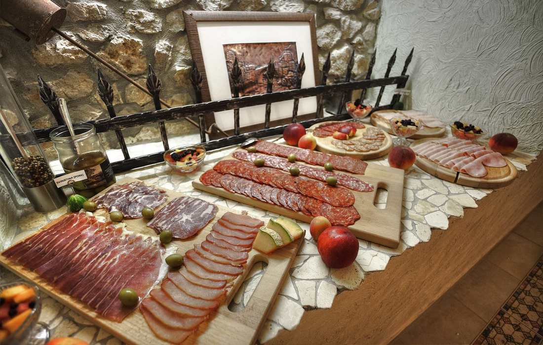 Continental breakfast with various cured meat products