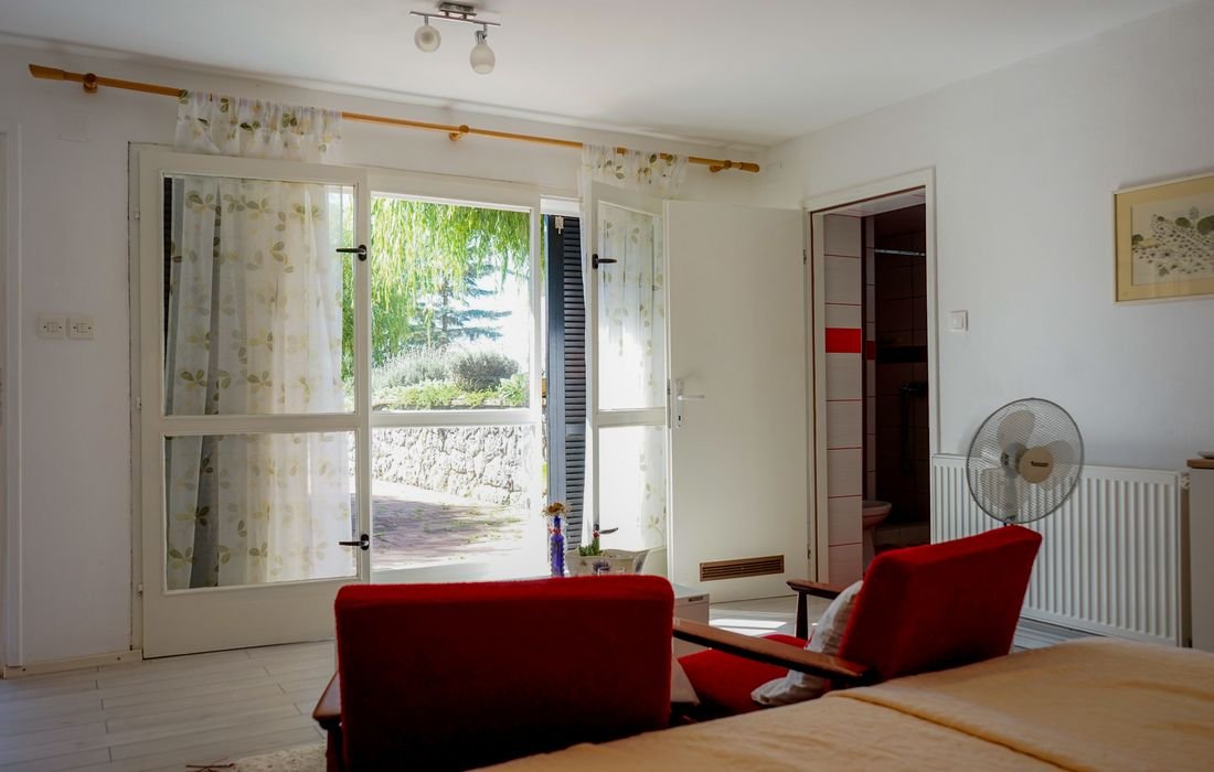 Bedroom with a sunny terrace in Holiday House Vrbovcanka
