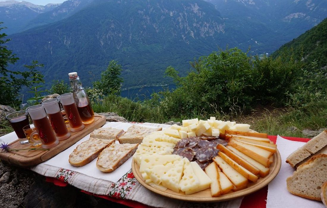 Mountain picnic over Lake Bohinj with local products